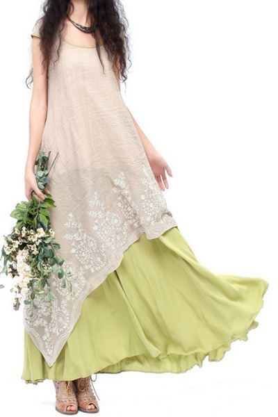 Long pista green skirt with asymmetric kurti. Awesome combination for day parties