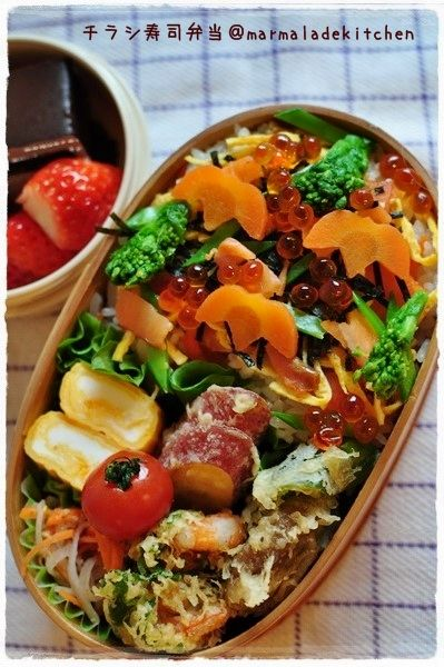 A colorful chirashizushi bento, using two bento-safe fish ingredients, smoked salmon and ikura or salmon caviar. (NEVER use raw fish in a bento you're going to eat hours later.)
