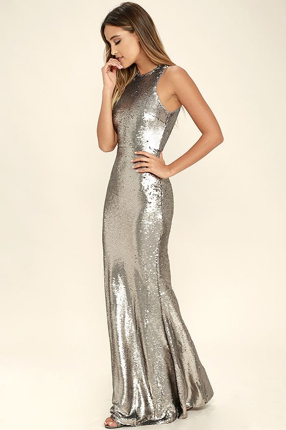 Your beauty will be known for miles around when you slip into the Notorious Matte Silver Sequin Maxi Dress! Matte silver sequins sparkle atop a sleeveless, darted bodice with a rounded neckline. Fitted bodice gives way to a flaring mermaid maxi skirt. Hidden back zipper and clasp.