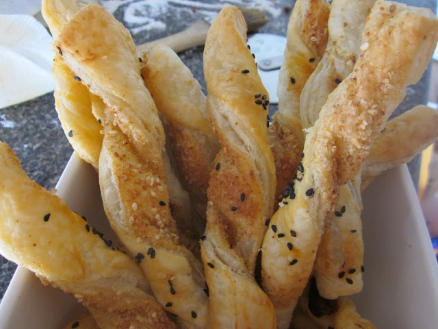 Easy Modern Asian: Sesame Twists    Puff pastry sprinkled with toasted sesame seeds, sugar and salt. Twist it up, brush with eggwash, sprinkle with black sesame seeds and bake at 425F  til golden. Fun appetizer - just in time for the holidays!