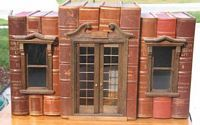 Artist who makes miniature houses out of books. Website is updated regularly.