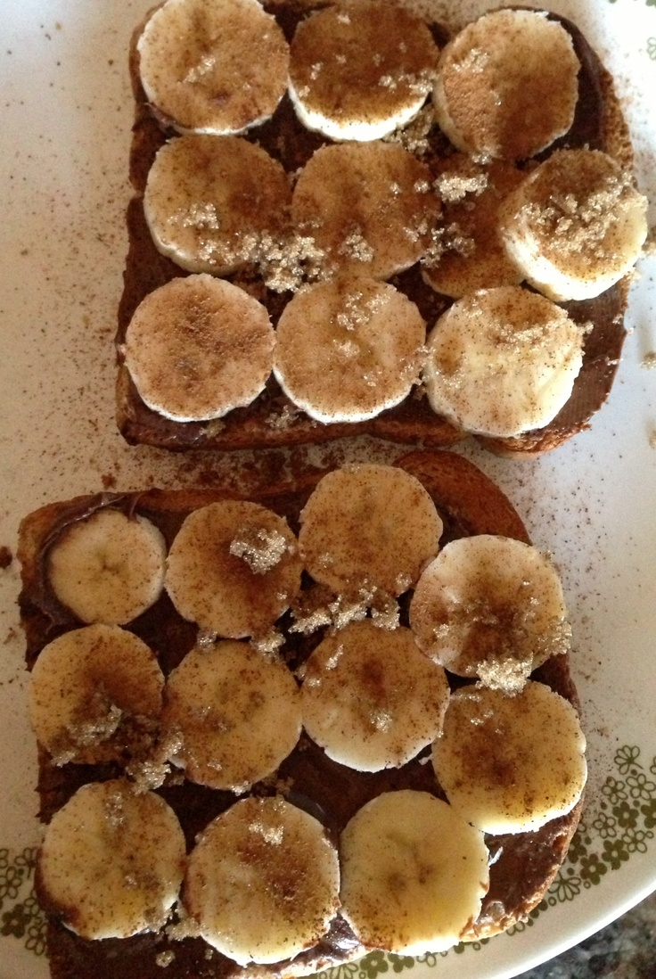 Mmm so good!  So to have your taste buds thanking you here's what to do!  Make toast, spread on Nutella, cut up banana, and then sprinkle cinnamon and brown sugar on top.  You're welcome.