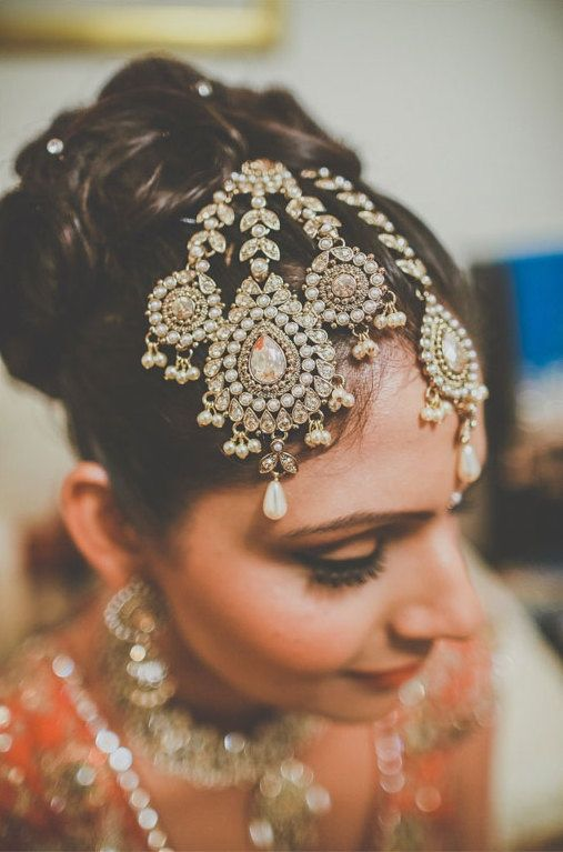 Idea for altering existing gold, costume piece necklace - tikka jhoomar Indian bride jewelry in peach lehnga. More here: http://www.indianweddingsite.com/10-maang-tikka-jhoomar-looks/