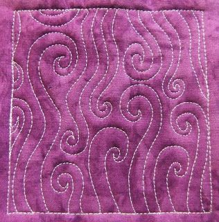 Quilting motif I like; I could see this one on the border of a fall or snowman quilt (looks like wind) or steam above a coffee mug.