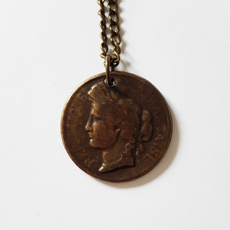 Bronskleurige metalen ketting met 'vintage munt' republique francaise
