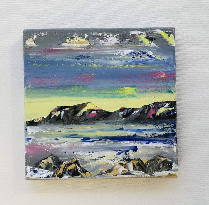 An abstract painting of a seascape. Mountains, rocks and a colourful sky. Painted with water soluble oil paint.