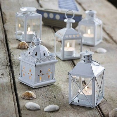 Add magic and ambience to your garden parties and BBQs this year after the sun sets. This Set of 5 Metal Lanterns all in different styles are eclectic and interesting. They'll add that unique touch to your home or garden this summer.