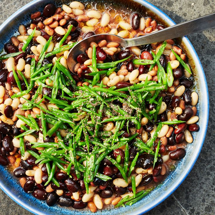 All types of beans come in and out of season during the summer and into fall; make this with any color snap beans and your choice of fresh or canned shelling beans.