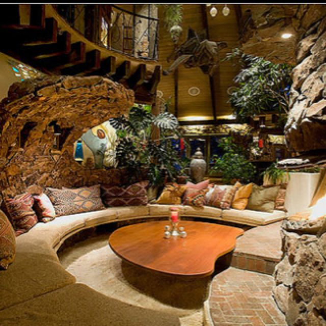 A conversation pit in an underground home with a timelessly interesting style