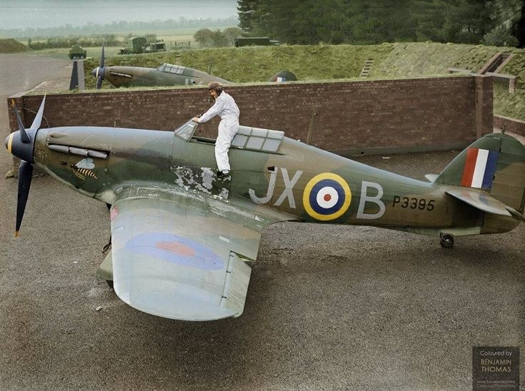 """Pilot Officer Arthur """"Taffy"""" Clowes of No. 1 Squadron RAF, climbing into his Hawker Hurricane Mk1 (P3395 """"JX-B""""), in a revetment at RAF Wittering, Huntingdonshire 1st October 1940"""