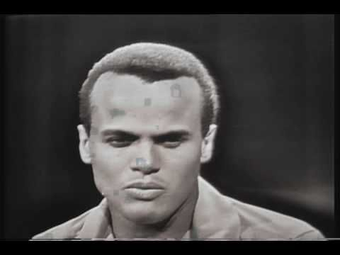 Harry Belafonte - Island In The Sun Impossible not to sing along to this.....One of my first ever records.