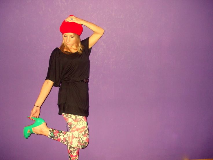 Jole in Jimmy Choo for H&M dress, colored leggins and  green pumps Versace