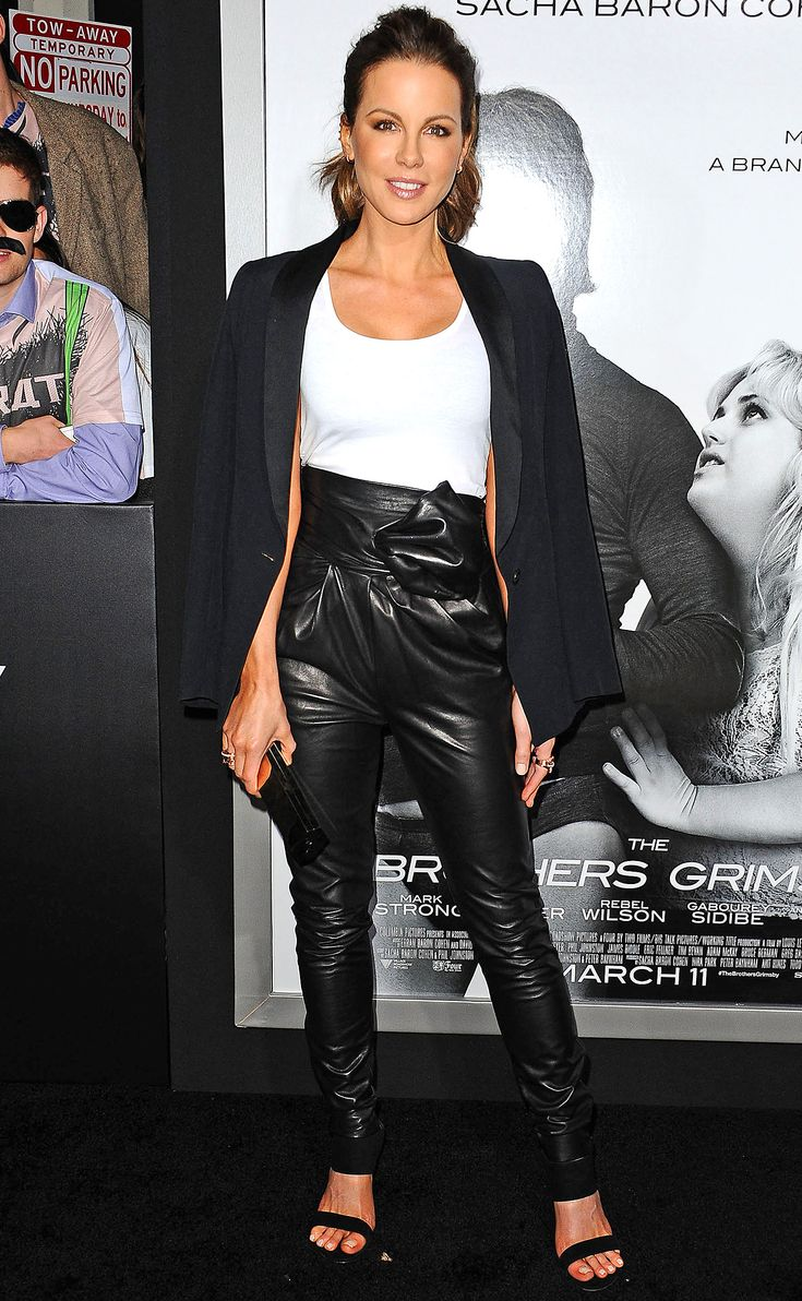 KATE BECKINSALE in a white top and high-waisted leather skinnies (both Vionnet) under a Cristiano Burani black blazer, plus jewels by Le Vian and Borgioni and a Lee Savage clutch, at the premiere of The Brothers Grimsby in L.A.