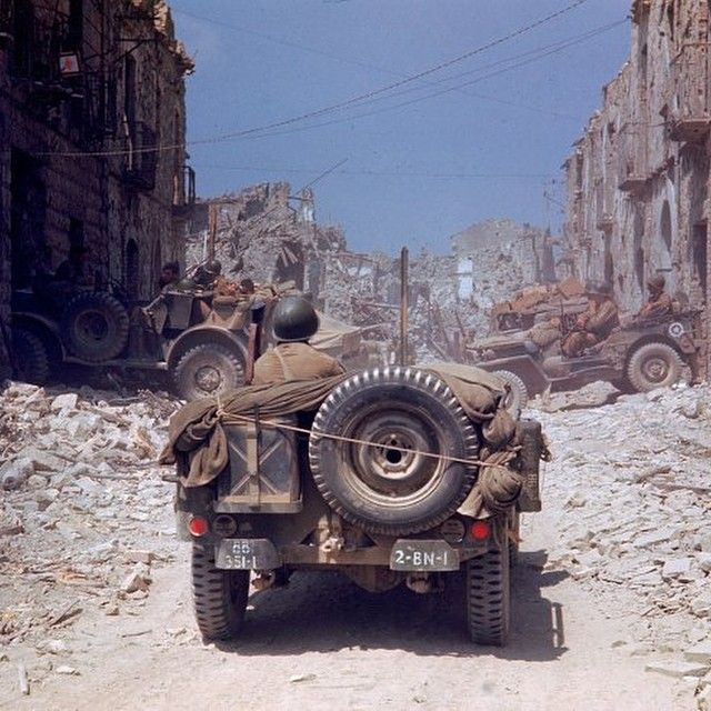 A Willys Jeep driving through the ruins of Cassino, Italy.  Guys do you want me post any specific catagory of the Western Front? Like: Italy, Normandy, Belgium, France overall, Germany, Holland and Norway. #wwii #ww2 #us #usa #medics #medic #usarmy #italy #italian #monte #cassino #italia #jeep