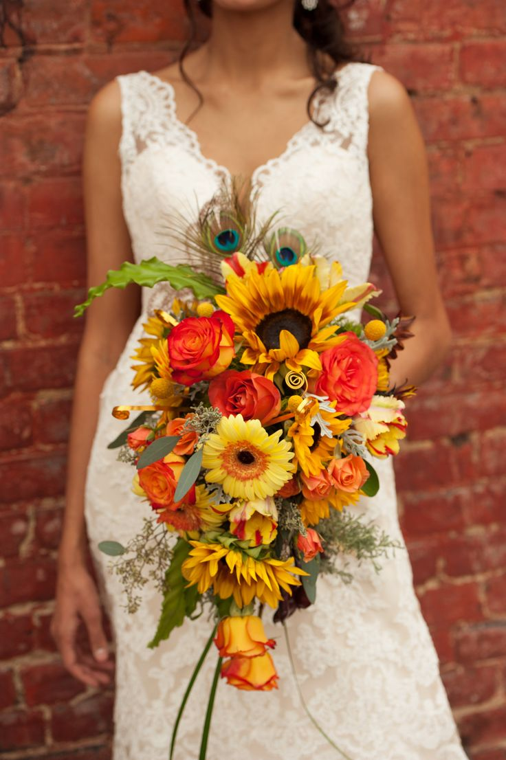 ♡ Sunflower cascading #wedding #Bouquet ... For wedding ideas, plus how to organise an entire wedding, within any budget ... https://itunes.apple.com/us/app/the-gold-wedding-planner/id498112599?ls=1=8 ♥ THE GOLD WEDDING PLANNER iPhone App ♥  For more wedding inspiration http://pinterest.com/groomsandbrides/boards/ photo pinned with love & light, to help you plan your wedding easily ♡