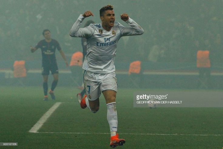 Real Madrid's Portuguese forward Cristiano Ronaldo celebrates after scoring the opening goal during the UEFA Champions League round of 16 second leg football match between Paris Saint-Germain (PSG) and Real Madrid on March 6, 2018, at the Parc des Princes stadium in Paris. /