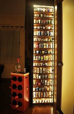 Beautiful shot glass display with LED lighting.  And pretty funny because my boyfriend already collects them :)