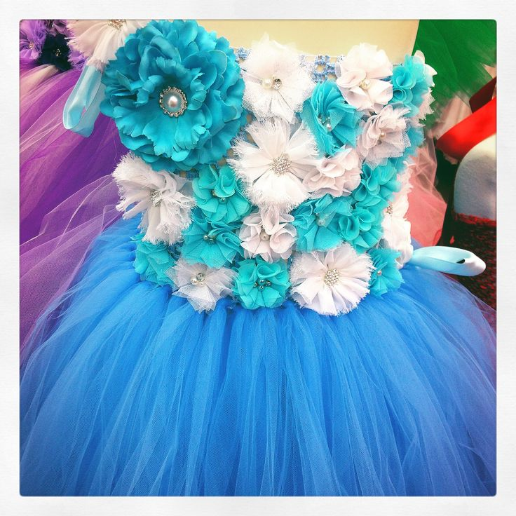 We now make petal embellished tutu dresses! Visit www.lilmissdressup.com to choose your colours and style