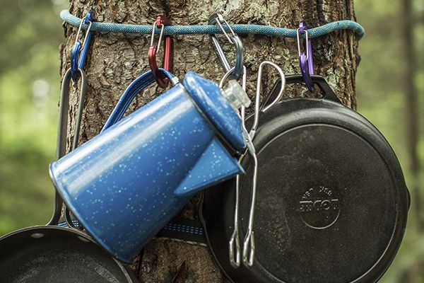 Camp Cooking Hack #5: If you're a climber, you're with a climber or you just like to bring climbing gear wherever you go, loop a rope around a tree and hang pots, pans and utensils from it using carabiners.
