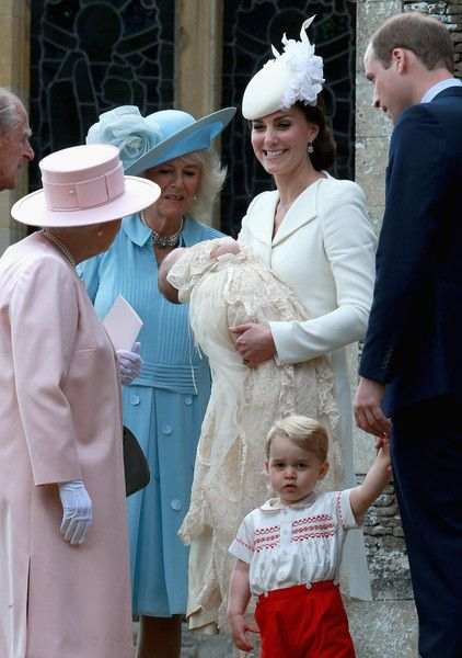 Catherine, Duchess of Cambridge, Prince William, Duke of Cambridge, Princess Charlotte of Cambridge and Prince George of Cambridge talk to Queen Elizabeth II, Prince Phillip, Duke of Cambridge and Camilla, Duchess of Cornwall arrive at the Church of St Mary Magdalene on the Sandringham Estate for the Christening of Princess Charlotte of Cambridge on July 5, 2015 in King's Lynn, England.