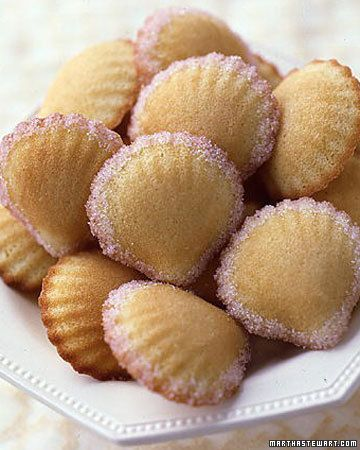 Madeleines edged in pale pink sugar and baked in unusual scallop-shell shapes