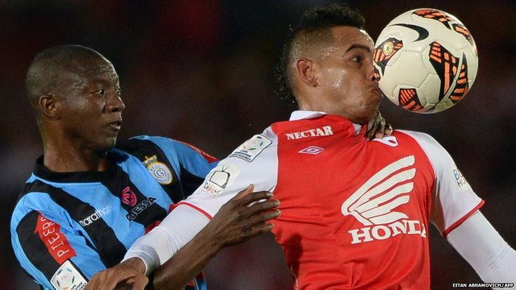 Wilder Medina of Colombia's Santa Fe fights for the ball with Peru's Joel Herrera of Real Garcilaso during their Copa Libertadores football match at El Campin stadium in Bogota, Colombia. --BBC 2013