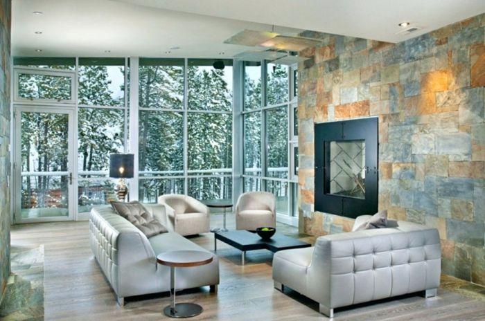 Ein Wonzimmer Im Haus Mit Panorama, Natürliches Licht Und Indirekte  Beleuchtung Steinwand Wohnzimmer