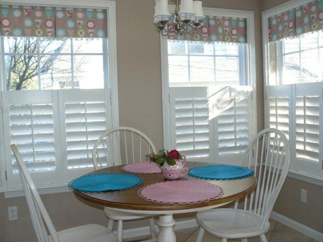 Cafe Shutters with a fabric valance Really like these