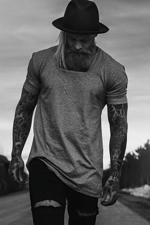 Hat, tattoos and beard.