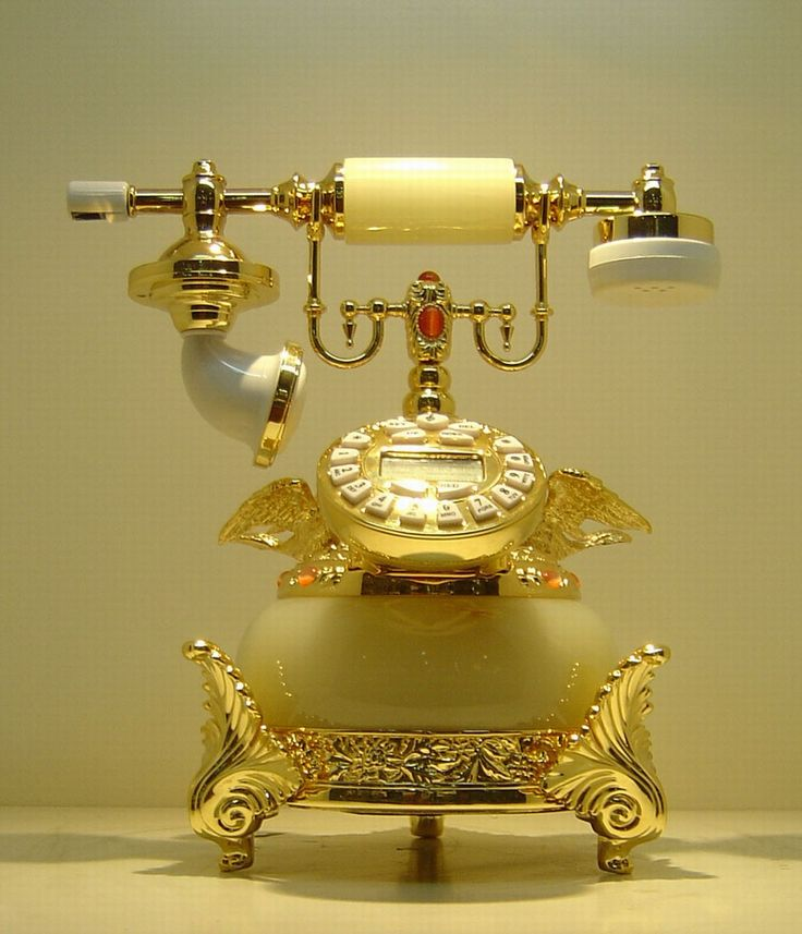 "Antique telephone-- while not a very ""smart phone"" --- it is now indeed a beautiful decorative accessory!"