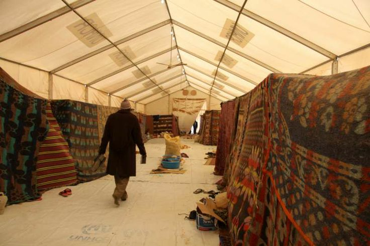 One of the massive tents or rubb halls erected by UNHCR at the Sallum crossing. Each tent provides accommodation for either women and children ou2026 & One of the massive tents or rubb halls erected by UNHCR at the ...