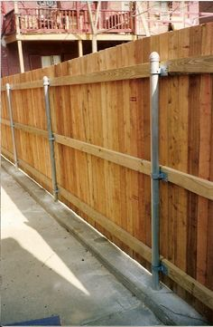 convert a chain link fence to a wooden fence