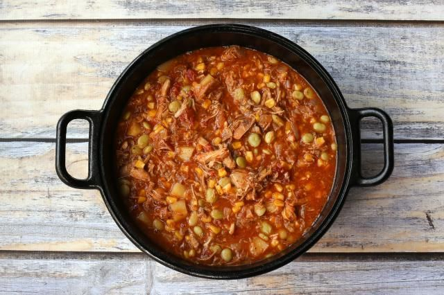 This easy Brunswick stew recipe is made with a combination of pulled or shredded pork and shredded chicken thighs, and it's ready in an hour. It's a budget-friendly classic, perfect for an everyday family meal.