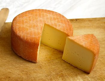 Oka is a semi-firm cheese with a rind and a strong aroma. It was first created by monks in Quebec.