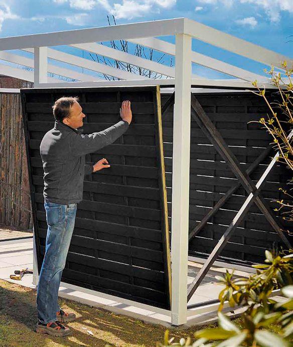Bygg ett skjul av färdiga vindskydd. Det är lätt att bygga, priset är överkomligt, resultatet blir snyggt och du kan bygga det på bara några dagar.