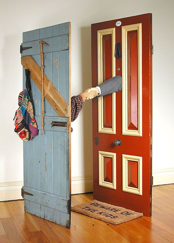 Next-Door Neighbours, 2000 carved salvaged Huon pine, cedar door, hardwood door, sleeves, walking stick, bag, bullet casings 202 x 103 x 98 cm by © Susan Dorothea White