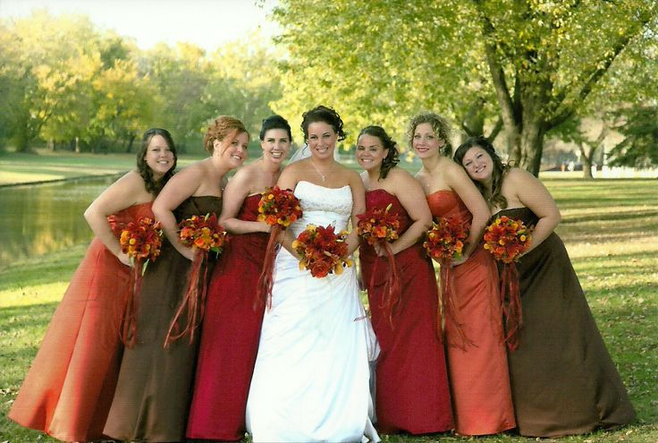 Bridesmaid dresses in fall colors! I love that they are wearing all different colors!!!