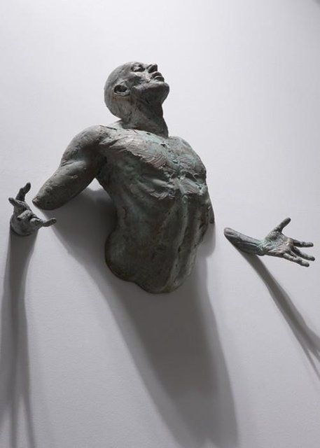 Human Sculpture coming out from wall