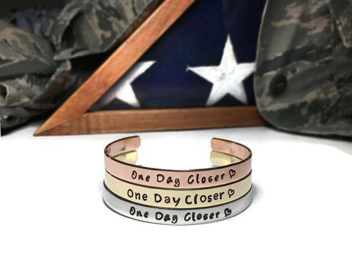 A personal favorite from my Etsy shop https://www.etsy.com/listing/267839303/one-day-closer-deployment-bracelet-metal