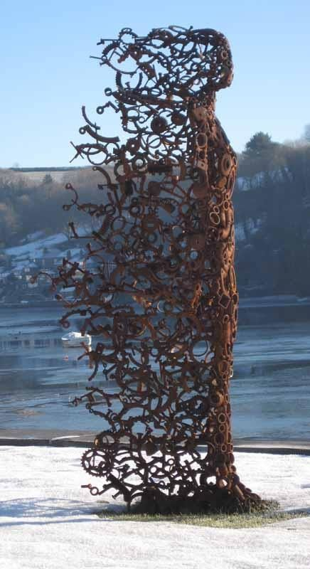 "Sculpture made from old rusty metal parts titled ""You Blew Me Away"" by Penny Hardy."
