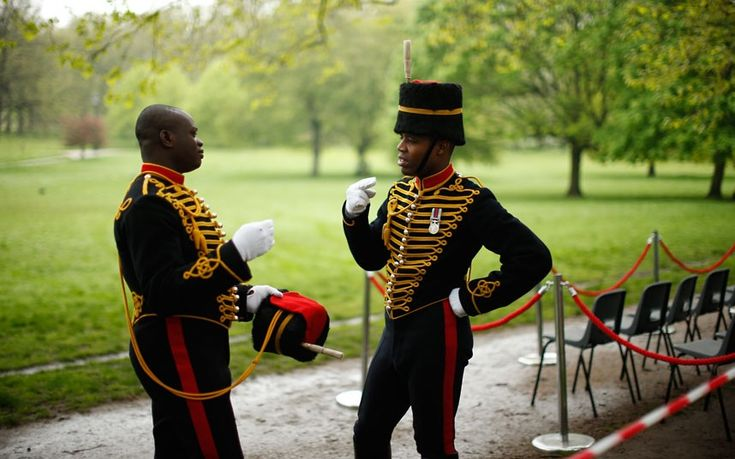 Members of the King's Troop Royal Horse Artillery talk prior to the firing of a 41 gun salute at Green Park