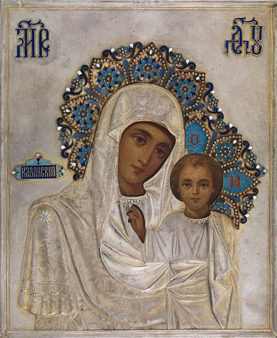 MOTHER OF GOD OF KAZAN IN A SILVER-GILT AND ENAMELLED OKLAD  BEGINNING OF THE 20TH CENTURY, MAKER'S MARK SG IN CYRILLIC, 1899-1908, HALOS OF A LATER PERIOD