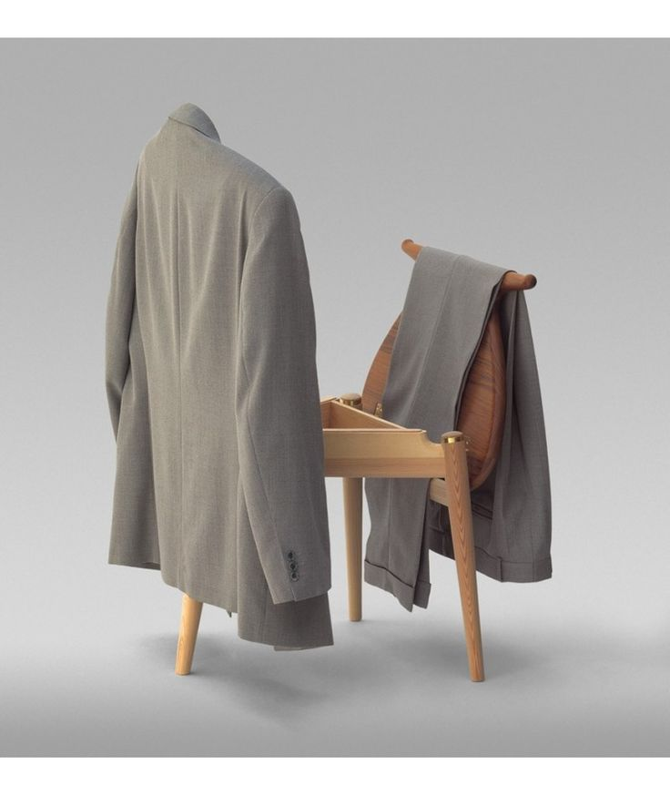 The beautiful wooden Valet chair by Hans Wegner was designed for hanging clothes at bedtime.