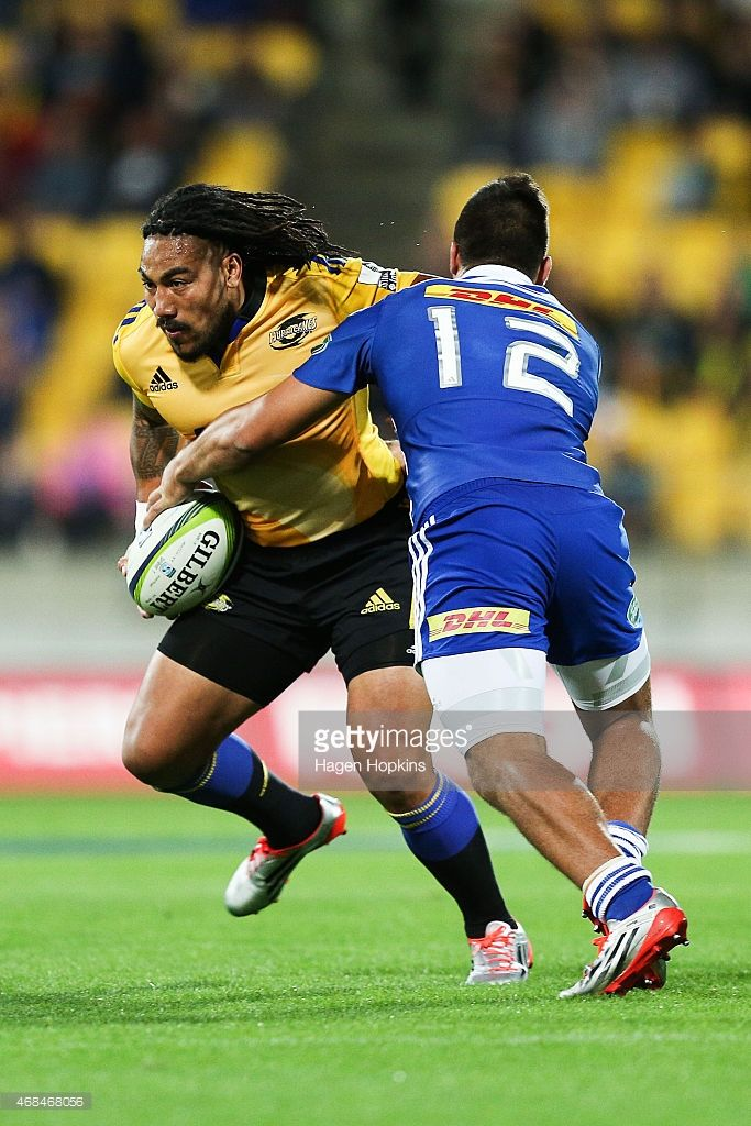 Ma'a Nonu of the Hurricanes is tackled by Damian de Allende of the Stormers during the round...