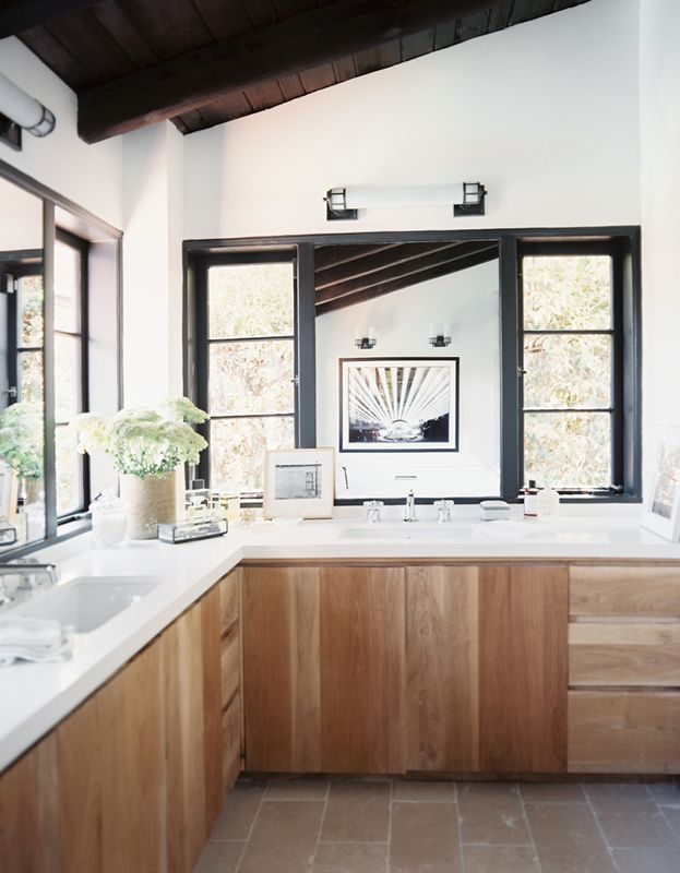 wood cabinets, white walls, white countertops / fresh bathroom design