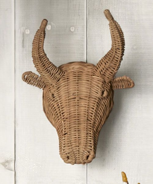 No bull about it — this rowdy animal takes a surprisingly delicate turn in wicker.  ($49; ballarddesigns.com)   - CountryLiving.com