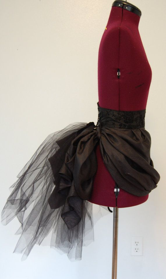 The belt part of the bustle is made from a black flocked taffeta. The back edges have light weight flexible boning in them so it will keep its shape.