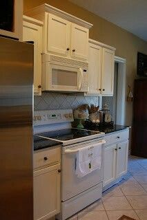 Move cabinet up to fit an over-the-range microwave.