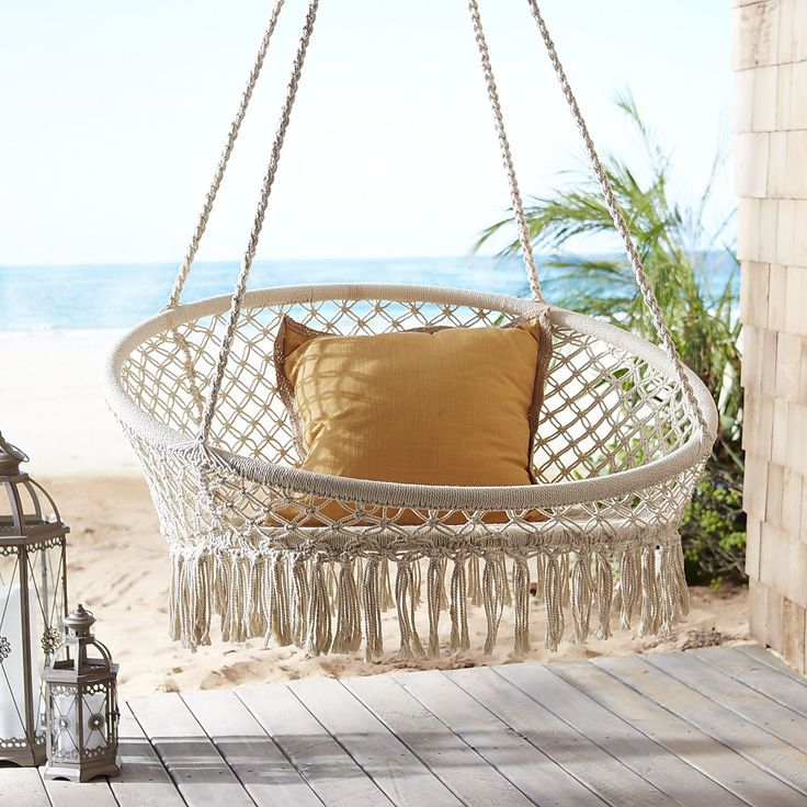 The easy-living leisure of a hammock meets the freewheeling fun of a swing in our unique, handcrafted saucer chair. Its sturdy wrought iron frame is dressed up with white ropes that have been knotted macrame-style to form a laid-back design. Just hang it from our Swingasan® stand (sold separately) and relax.