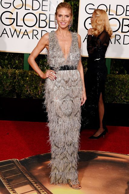 The Boldest Looks From This Year's Golden Globes Red Carpet #refinery29  http://www.refinery29.com/2016/01/100855/golden-globes-2016-red-carpet-best-dressed#slide-32  Heidi Klum Leave it to Heidi Klum to channel the '20s in a fringed Marchesa dress. Normally, we like to be surprised when it comes to the red carpet. But Klum's old reliable seems to get us every single time....